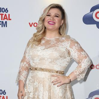 Kelly Clarkson: My weight means I'm happy