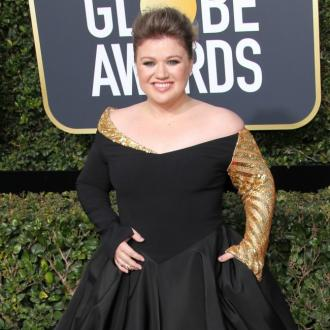 Kelly Clarkson is staying positive amid divorce: 'I feel pretty good and happy'