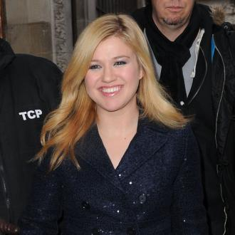 Kelly Clarkson Hides Awards