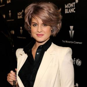 Loved-up Kelly Osbourne