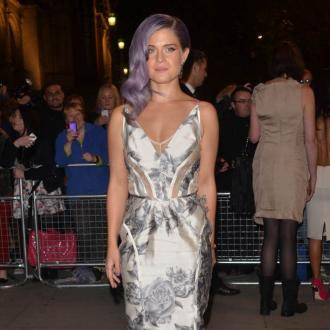 Kelly Osbourne Gets Champagne After Construction Pain