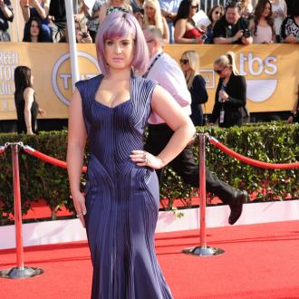 Kelly Osbourne Wore Platform Sneakers Under Oscars Gown