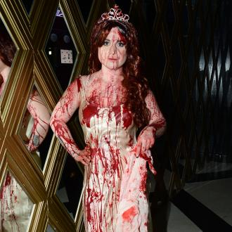 Kelly Osbourne Dresses As Carrie For Halloween
