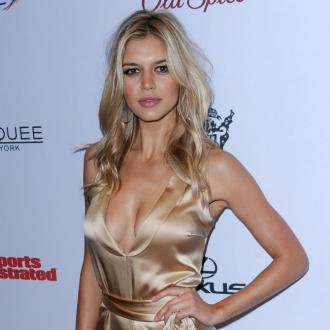 Kelly Rohrbach Says Wearing Baywatch Swimsuit Hid Her Burger Bulge