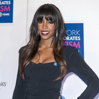 Kelly Rowland too shy to sing at wedding