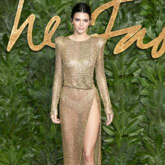 Kendall Jenner goes bold in bare gown at British Fashion Awards