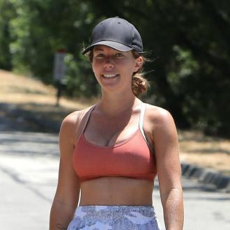 Kendra Wilkinson defends breast implants