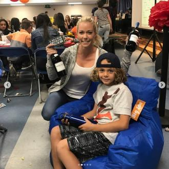 Kendra Wilkinson 'can't stop smiling' after day with son