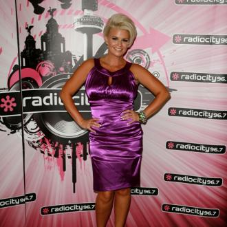 Kerry Katona in pain with trigger finger