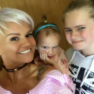 Kerry Katona cuts hair in support of toddler daughter