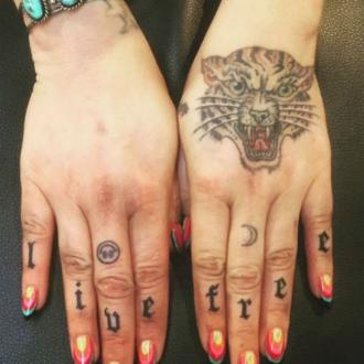 Kesha Gets Knuckle Tattoo