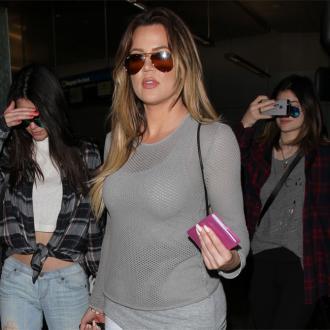 Khloe Kardashian Wears French Montana Necklace