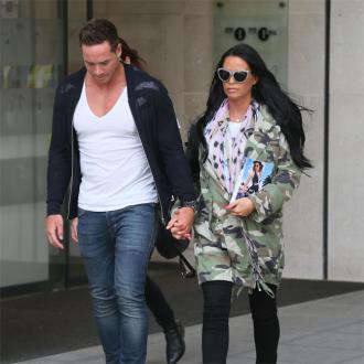 Katie Price's husband flirted in front of her