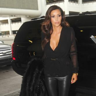 Kim Kardashian 'Handcuffed' To Kris Humphries