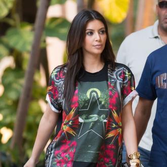 Kim Kardashian Poses A Gift Problem