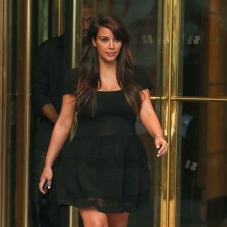 Kim Kardashian Tried To Hide Pregnant Body