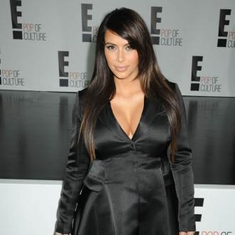 Kim Kardashian Loves Her New Curves