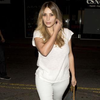 Kim Kardashian Has A 'Booty Tailor' On Call