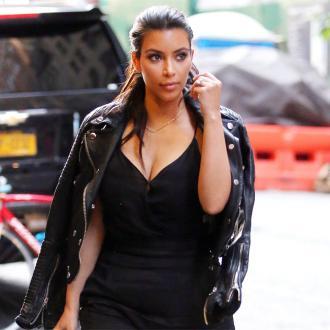 Kim Kardashian Slams Adrienne Bailon