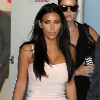 Kim Kardashian West forgives Adrienne Bailon