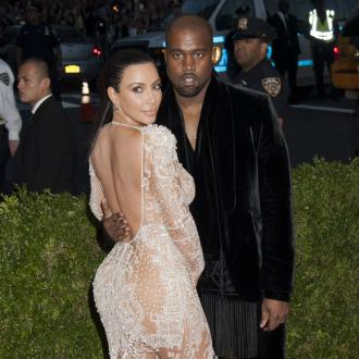 Kim Kardashian + Kanye West 'definitely opposites'