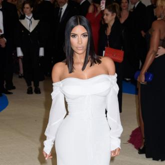 Kim Kardashian West flies solo at Met Gala