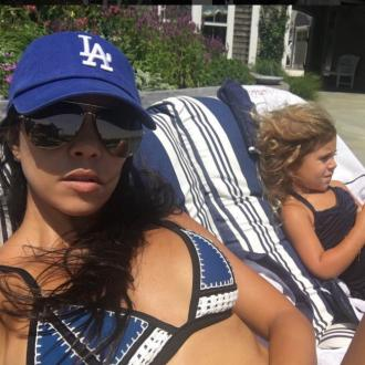Kourtney Kardashian holidaying with Scott