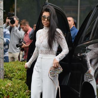Kourtney Kardashian romancing younger model