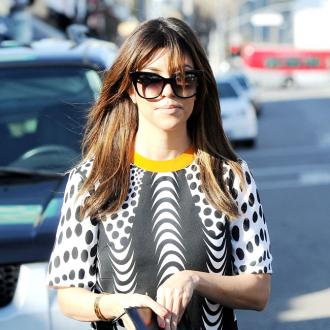 Kourtney Kardashian Could Be Surrogate
