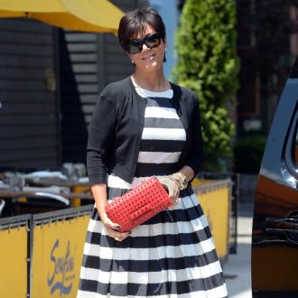 Kris Jenner Deals With Business During Workout