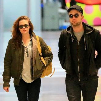 Kristen Stewart And Robert Pattinson Host Christmas Party