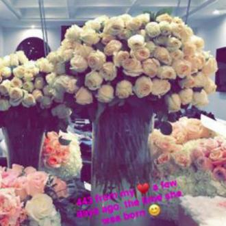 Travis Scott sends Kylie Jenner 443 white roses after daughter's birth
