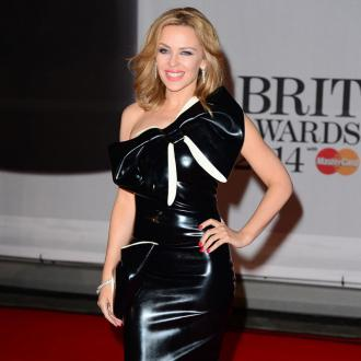 Kylie Minogue had first kiss in a swimming pool
