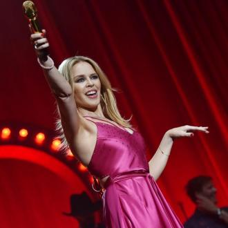 Kylie Minogue and Jason Donovan reunite on stage