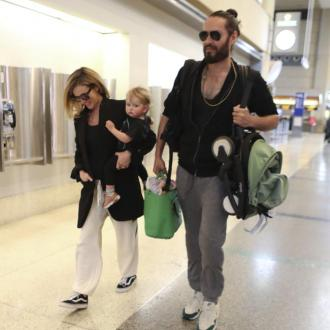 Russell Brand jokes fatherhood is sending him grey