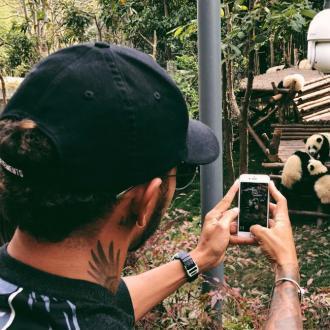 Lewis Hamilton visits panda sanctuary