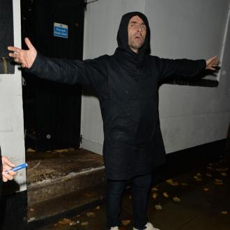 Liam Gallagher Gets Fan To Peel A Potato During Gig