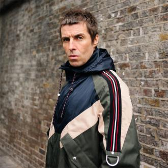 Liam Gallagher jokes he deserves son's modelling money
