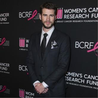 Liam Hemsworth is 'living a different life' since divorce