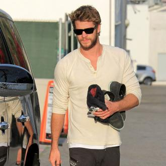 Liam Hemsworth Jokes He's More Talented Than Brothers
