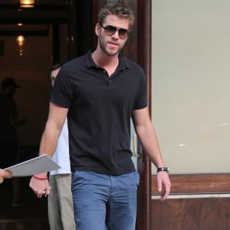 Liam Hemsworth Ignoring Miley Cyrus