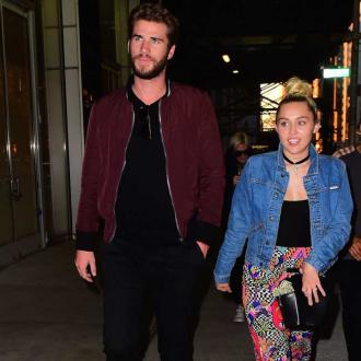 Miley Cyrus and Liam Hemsworth enjoy family dinner