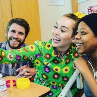 Liam Hemsworth supports Miley Cyrus at children's hospital