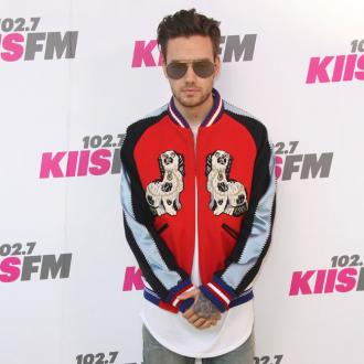 Liam Payne apologises for threesome track