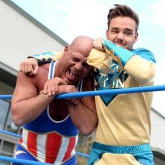 Liam Payne grapples with wrestling star Kurt Angle