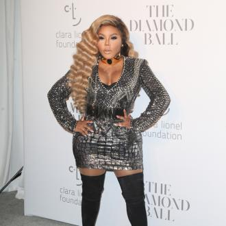 Lil Kim's tribute to Kim Porter