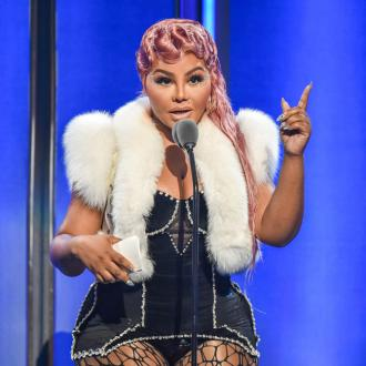 Lil' Kim's shoes she paired with her iconic 1999 Met Gala look were too big