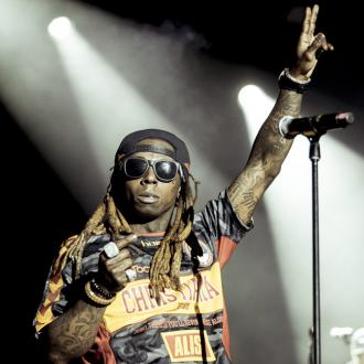 Lil Wayne insists all fine after FBI search