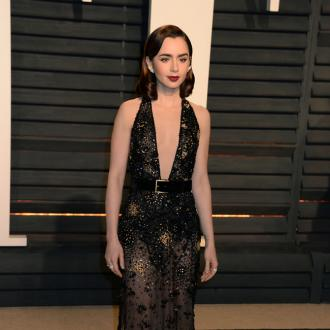 Lily Collins loves to 'take chances' with her red carpet outfits