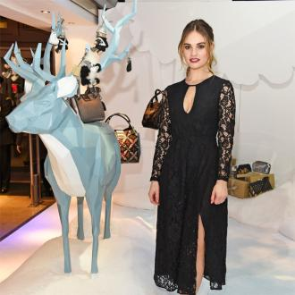 Lily James switches on the Burberry Christmas lights at Harrods